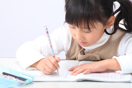 Schoolgirl writing in Japan