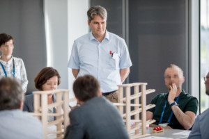 Bottleneck Walk Poland - Me giving a bottleneck walk training at the Lean Poland conference in 2018. Faces are blurred for privacy. Copyright with the Lean Poland institute.
