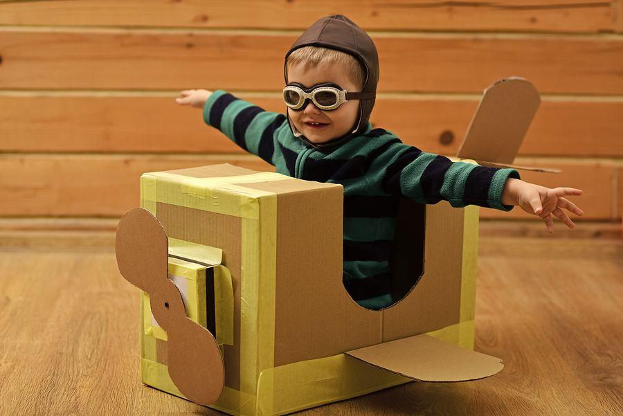 Kid in a cardboard Paper Plane