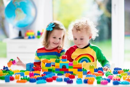 Kids playing with colorful plastic blocks