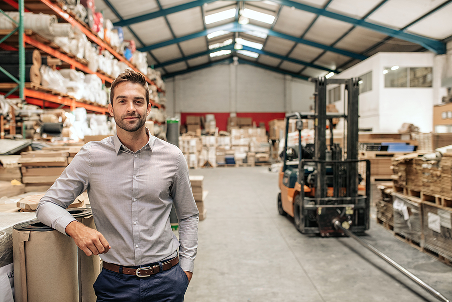 Smiling Manager in a Warehouse