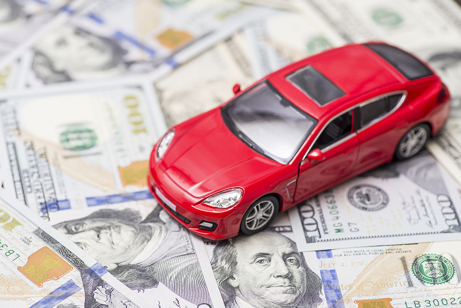 Red Toy Car On Dollar Banknotes